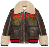 Gucci Embroidered leather bomber with shearling lining