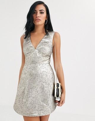 The Girlcode mini skater dress in silver metallic