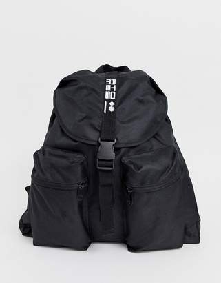 Asos Design DESIGN backpack in black with double front pockets and slogan strap