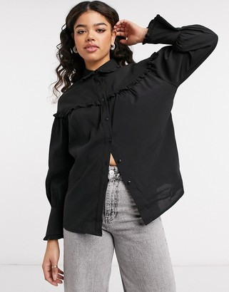 Object shirt with ruffle detail in black
