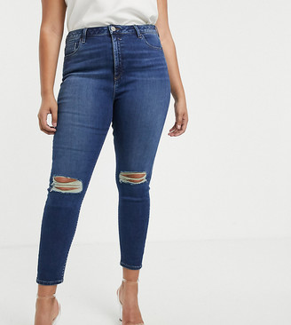 Asos DESIGN Curve Ridley high waisted skinny jeans in dark stonewash blue with busted knees