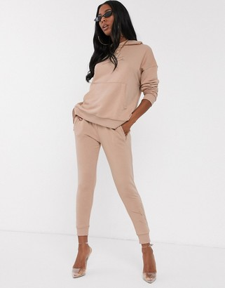 Club Skinny The Couture motif jogger in tan