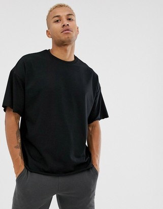 Asos DESIGN organic heavyweight oversized fit t-shirt with crew neck and raw edges in black