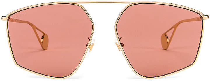 Gucci Shiny Gold Sunglasses in Red | FWRD