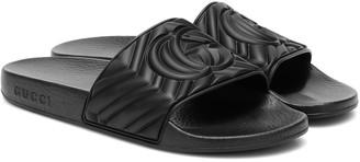 Gucci Embossed slides