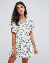 Yumi Cape Dress In Floral Print