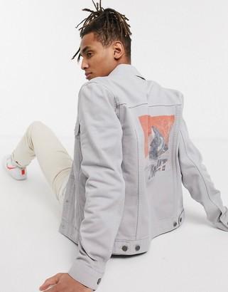 ASOS DESIGN denim jacket in grey with back print
