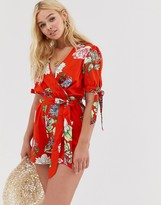 Influence wrap romper with puff tie sleeve in red floral