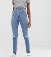 Asos DESIGN Tall Farleigh high waisted slim mom jeans in light vintage wash with busted knee and rip & repair detail