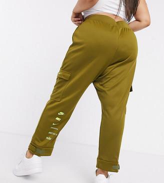 Nike Plus swoosh cargo pocket trackies in khaki green
