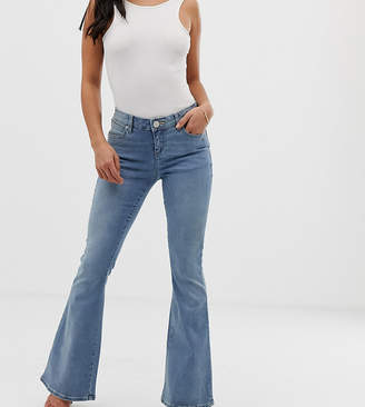 Asos DESIGN Petite super low rise flare jeans in mid wash blue
