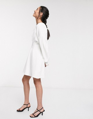 GHOSPELL mini dress with statement sleeves and pleated detail