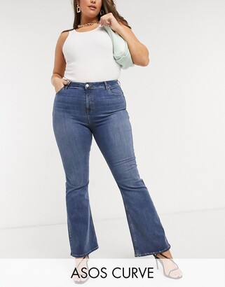 ASOS DESIGN Curve hourglass 'lift and contour' flare jeans in midwash