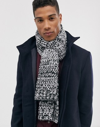 ASOS DESIGN knitted scarf in black and white twist