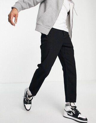 ASOS DESIGN relaxed tapered jeans in black