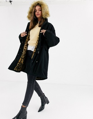 Asos Design DESIGN luxe parka with faux fur animal lining in black