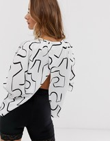 Asos Design DESIGN batwing top with wrap back in abstract print