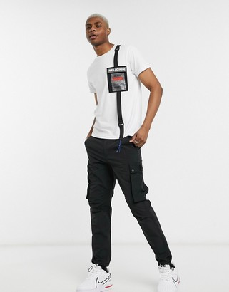 Religion utility t-shirt with rubberised logo pocket in white