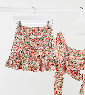 Collective the Label Petite ruched mini skirt co-ord with flippy hem in rose print