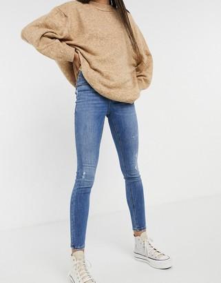 Vero Moda Sophia high rise skinny jean with distressing in medium blue