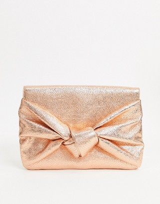 ASOS DESIGN clutch bag with oversized bow in rose gold