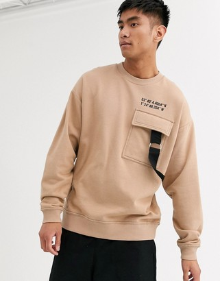 Asos Design DESIGN oversized sweatshirt with cargo chest pocket in stone & text print-Beige