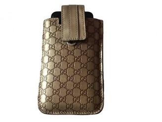 Gucci Metallic Leather Accessories