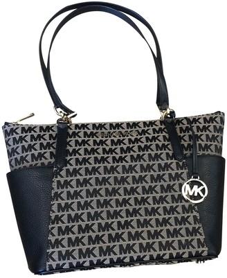 Michael Kors Bedford Beige Cloth Handbags