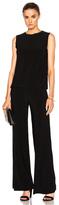 Norma Kamali Sleeveless Babydoll Jumpsuit in Black.