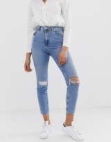 Asos DESIGN Farleigh high waisted slim mom jeans in light vintage wash with busted knee and rip & repair detail