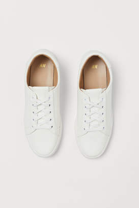 H&M Snakeskin-patterned trainers