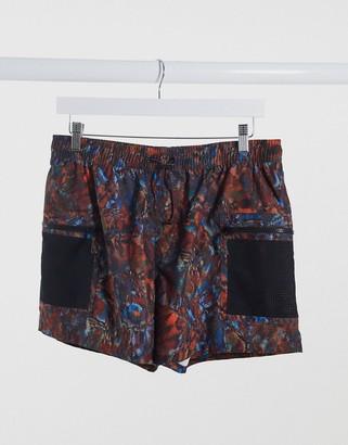ASOS DESIGN swim shorts in animal print with cargo pockets short length