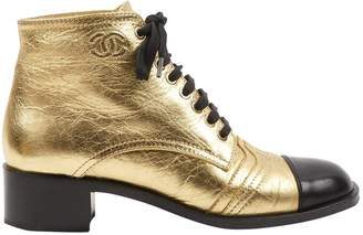 Chanel Gold Leather Boots