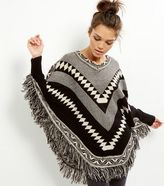 Yumi Black V Neck Abstract Print Tassel Hem Poncho