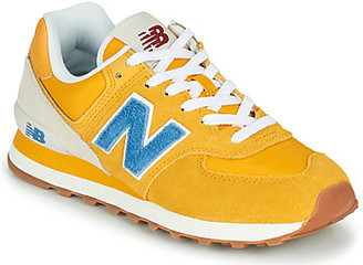 New Balance 574 women's Shoes (Trainers) in Yellow