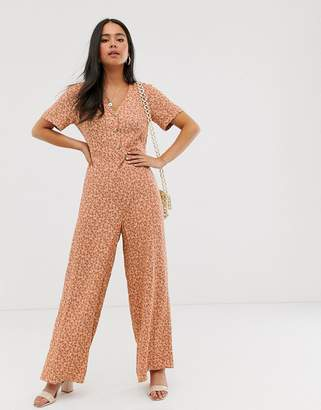 New Look button through jumpsuit in orange ditsy print-Pink