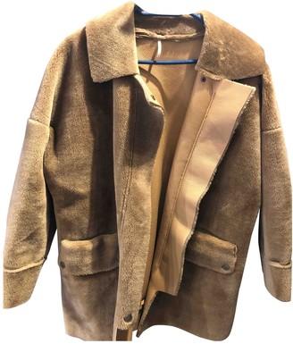 Free People Beige Faux fur Coats