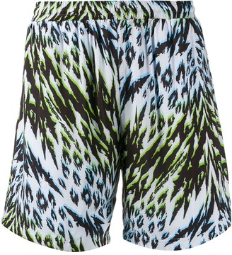 Aries animal print board shorts