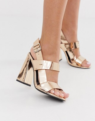 Co Wren curved block heeled sandals in rose gold