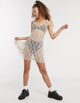 New Girl Order sheer lace mini dress with embroidery and bow detail