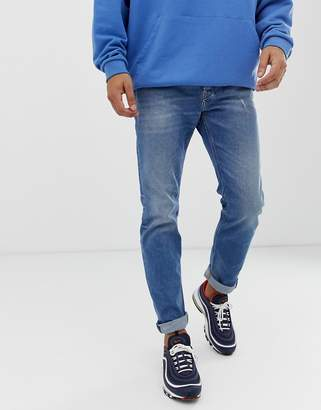 Diesel Larkee-Beex regular tapered fit jeans in 089AW mid wash-Blue
