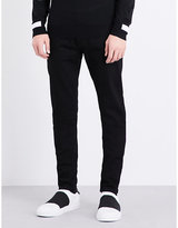 Givenchy Star-appliqué Slim-fit Tapered Jeans