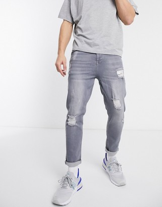 ASOS DESIGN tapered jeans in washed gray with abrasions