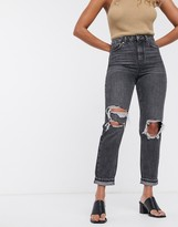 Topshop mom jeans with double knee rips in washed black