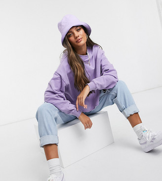 ASOS DESIGN Petite oversized sweat with raw edge detail in washed purple
