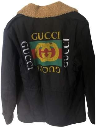 Gucci Black Faux fur Coats