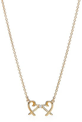 Tiffany & Co. Paloma Picasso Double Loving Heart pendant in 18ct gold with diamonds