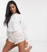 Puma Fleece shorts in beige