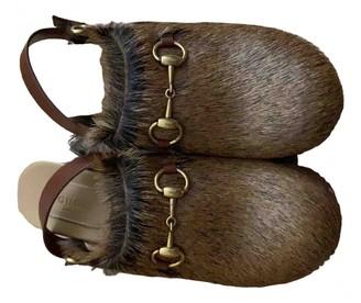 Gucci Brown Fur Mules & Clogs