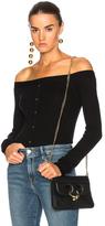 Frame Off the Shoulder Cardigan in Black.